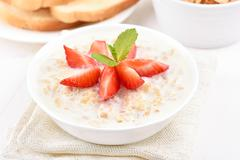 Oatmeal porridge - stock photo