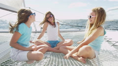 Smiling Young Caucasian Girls Children Luxury Yacht Ocean Travel Insurance - stock footage