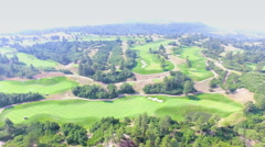 Aerial view of golf course surrounded by natural park. Stock Footage
