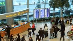 People near information board inside arrival hall Stock Footage