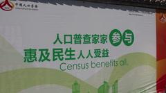 Chinese man smoking cigarette, 2010 Census Stock Footage
