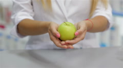 Close up of a pharmacist holding an apple Stock Footage