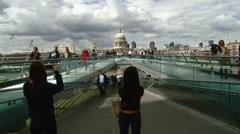 UK - London - Tourist Taking Photos of the Millennium Bridge with St. Pauls C Stock Footage