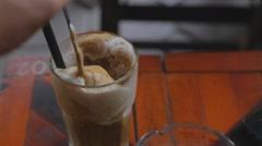 Stirring a vietnamese latte Stock Footage