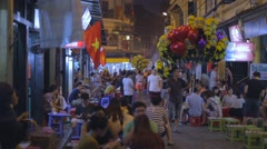 People drinking beer outdoors - Ta Hien old quarter Stock Footage