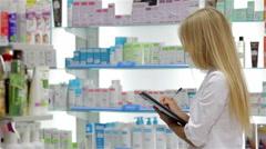 Pharmacist helping customer in pharmacy drugstore Stock Footage