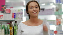 Cheerful young woman gives like for good medicicne Stock Footage
