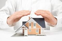 Protect house - insurance concept Stock Photos