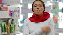 Young woman suffering from the sore throat - stock footage