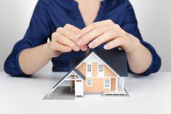 Protect house - insurance concept - stock photo