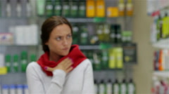Coughing young woman came to drugstore Stock Footage