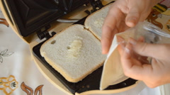 Cheese Into Sandwich Maker Stock Footage