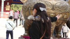 Touching Buddhist incense burner for luck Stock Footage