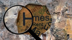 Magnifying glass on home text Stock Footage