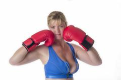 Stock Photo of Portrait of a female boxer in a sports bra and red boxing gloves