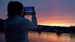 Taking pictures of the sunset with a tablet computer, iPad Stock Footage
