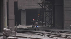 Chinese worker, factory train tracks, China Stock Footage