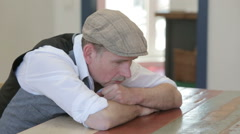 Man sitting at a table and looking thoughtful and depressed Stock Footage