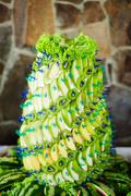 Sweet pyramid with green fruits - stock photo