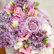 flower arrangement with lilac and eustoma flowers - stock photo