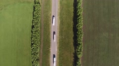 Trucks traveling on the road Stock Footage