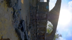 Vertical shot of Time-lapse of a stone ruins and light rays at Korazim, Israel. Stock Footage