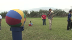 Stock Video Footage of Teenagers Play Big Ball in Peru attend a Christian Camp