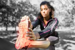 Highlighted ankle of stretching woman Stock Photos