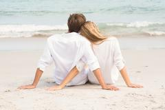 Wear view of couple hugging in front of sea - stock photo