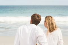 Wear view of couple looking at the sea Stock Photos