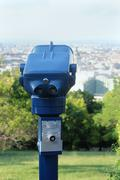 Coin operated binoculars viewer machine for tourists to look at landmarks Stock Photos