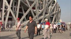 Tourists at Birds Nest Stadium, Beijing Stock Footage
