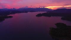 Vivid purple lake sunset Stock Footage