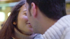 4K Attractive romantic couple kissing in mall cafe at Christmas time Stock Footage