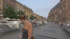 Stock Video Footage of Carriages waiting for tourists in the city center of Krakow