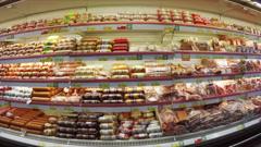 Shelves with food in supermarket, steadicam shot Stock Footage
