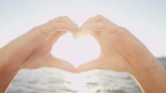 Female Caucasian Hands Heart Shape Photo Message Travel Tourism Ocean Sun Flare Stock Footage