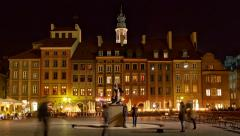 Tilt: Nightlife: People visit old town marketplace square, Warsaw, Poland Stock Footage