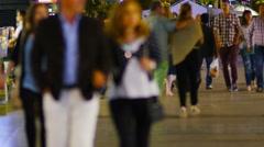 BARCELONA, multiple tourists strolling on Rambla boulevard at night. Stock Footage