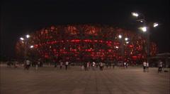 Birds Nest Stadium illuminated at night Stock Footage