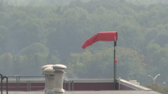 Windsock on Top of Commercial Building - stock footage
