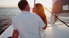 Loving Caucasian Couple Travel Holiday Luxury Yacht Carefree Sailing Sunset Kiss - stock footage