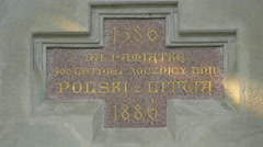 Inscription on the Jadwiga and Jagiello Monument in Krakow Stock Footage