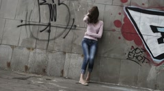 Upset depressed unhappy girl aimlessly standing alone, slow motion. - stock footage