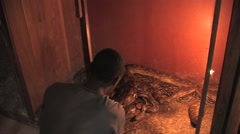 A Man gets out a Boa Constricter in Kitwe, Zambia Stock Footage