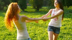 Friends, young girls, caucasians, having fun outdoors in nature, slow motion. Stock Footage