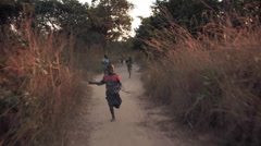 Cute Kids Running on Dirt Roads in Kitwe, Zambia - stock footage