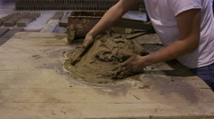 Kneading the clay - stock footage