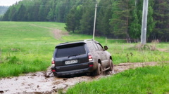 Toyota 4Runner  drive on the dirt in a field Stock Footage