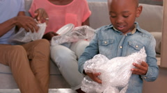 Stock Video Footage of Family unwrapping things in new home